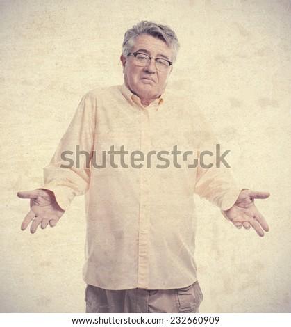senior cool man confused pose - stock photo