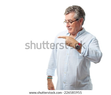 senior cool man pointing - stock photo