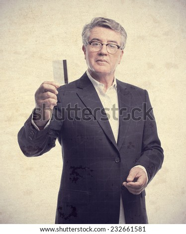 senior cool man with a credit card - stock photo