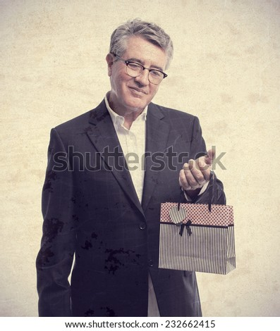senior cool man with a shopping bag - stock photo