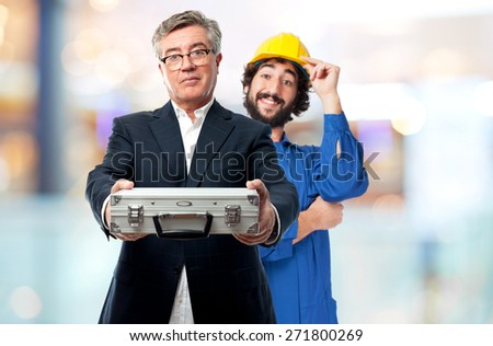 senior cool man with a steel briefcase - stock photo