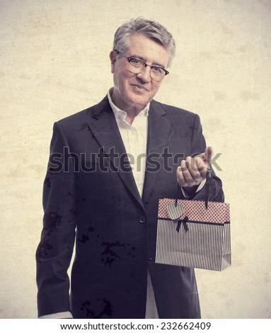 senior cool man with shopping bag - stock photo