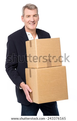 Senior corporate man holding stack of boxes