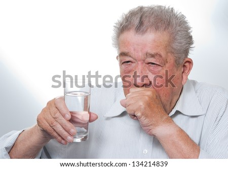 Senior coughs - stock photo