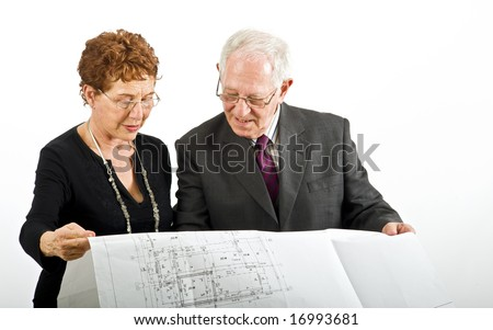 senior couple and house plans isolated on white - stock photo
