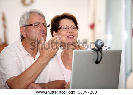 Senior couple and video call - stock photo