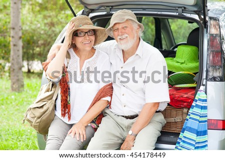 Senior couple arrive at holiday destination