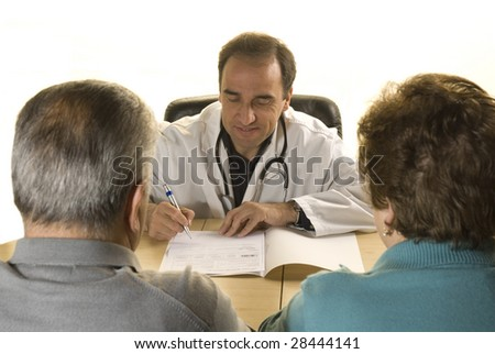 Senior couple at doctor's consultation on white background - stock photo