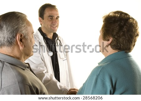 Senior couple at doctor's consultation on white background