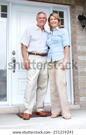 Senior couple at new home. Retirement security concept. - stock photo