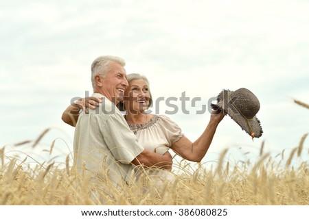 Senior couple at  summer field - stock photo