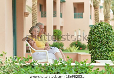 Senior couple at the resort during vacation - stock photo