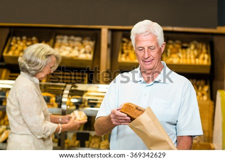 Senior couple buying bread at the bakery store