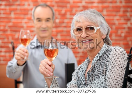 Senior couple celebrating anniversary in a restaurant - stock photo