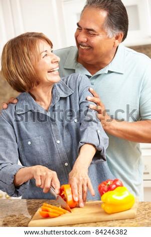 Senior couple cooking - stock photo