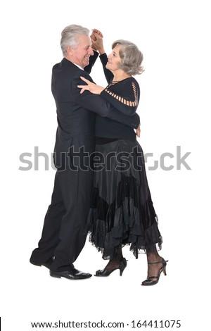 Senior couple dancing on white background - stock photo