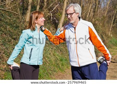 Senior couple doing their running exercises. - stock photo