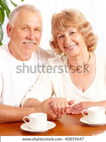Senior couple  drinking tea at home