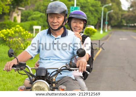 senior couple drive motorcycle to travel - stock photo