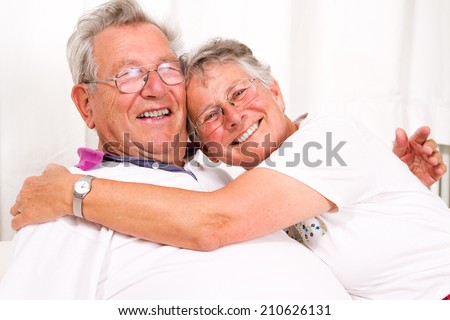 senior couple embracing each other  - stock photo