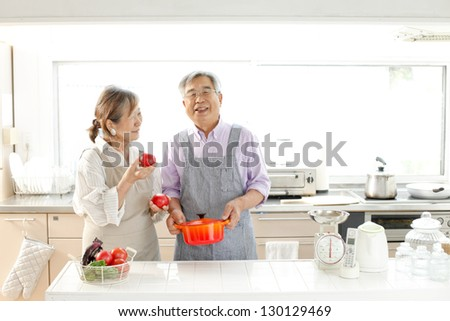 Senior couple enjoy cooking - stock photo