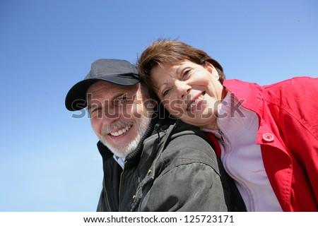 Senior couple enjoying a walk - stock photo