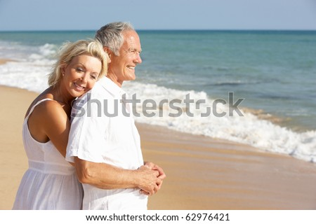 Senior Couple Enjoying Beach Holiday - stock photo