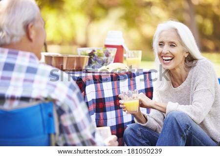 Senior Couple Enjoying Camping Holiday In Countryside - stock photo