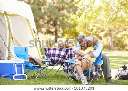 Senior Couple Enjoying Camping Holiday In Countryside - stock photo