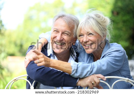 Senior couple enjoying day outside - stock photo