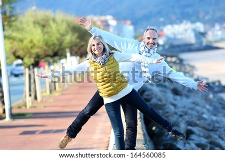Senior couple enjoying freedom - stock photo