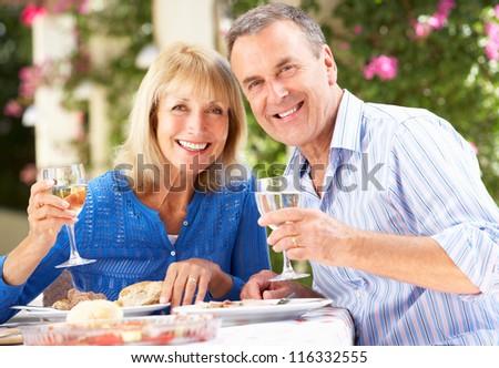 Senior Couple Enjoying Meal outdoorss - stock photo