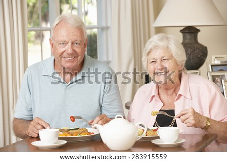 Senior Couple Enjoying Meal Together At Home