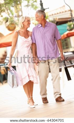 Senior Couple Enjoying Shopping Trip - stock photo