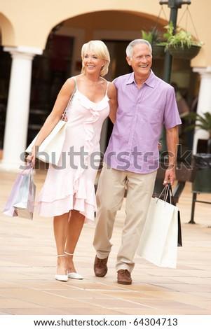 Senior Couple Enjoying Shopping Trip Together - stock photo