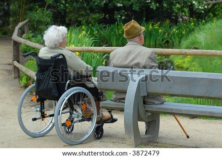 senior couple enjoying the park - stock photo