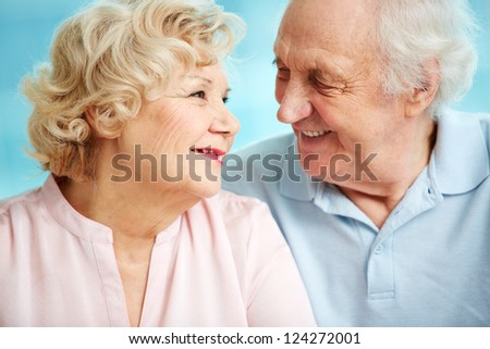 Senior couple exchanging affectionate looks - stock photo