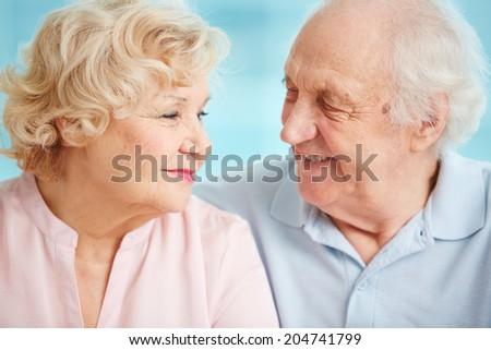 Senior couple exchanging affectionate looks - stock photo