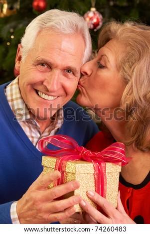 Senior Couple Exchanging Christmas Gifts - stock photo