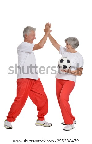 Senior couple exercising with ball and thumbs up on a white background - stock photo