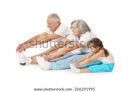 Senior couple exercising with granddaughter isolated on white background - stock photo