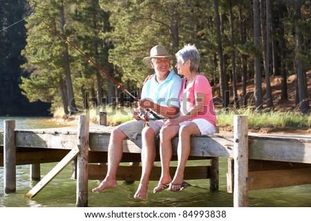 Senior couple fishing - stock photo