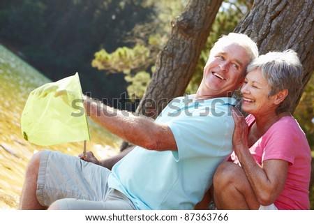 Senior couple fishing together - stock photo