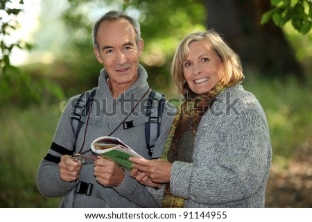 senior couple going for a walk - stock photo