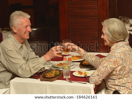 Senior couple having a dinner at restaurant - stock photo