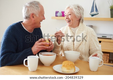 Senior Couple Having Bowl Of Soup For Lunch - stock photo