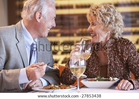 Senior Couple Having Dinner Together At A Restaurant - stock photo