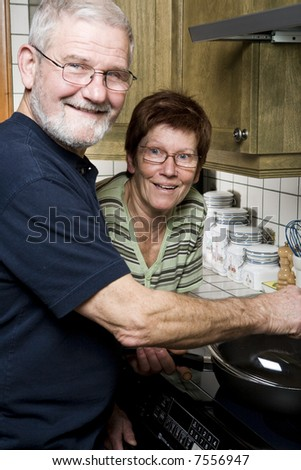 Senior couple having fun in the kitchen
