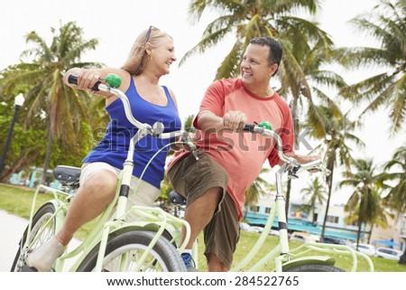 Senior Couple Having Fun On Bicycle Ride - stock photo