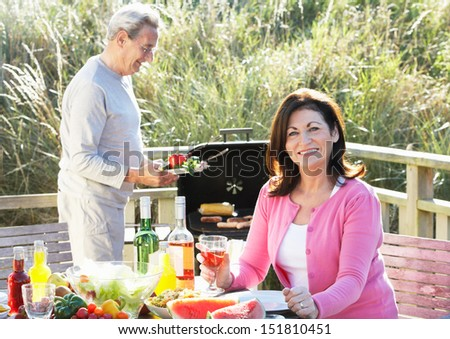 Senior Couple Having Outdoor Barbeque - stock photo